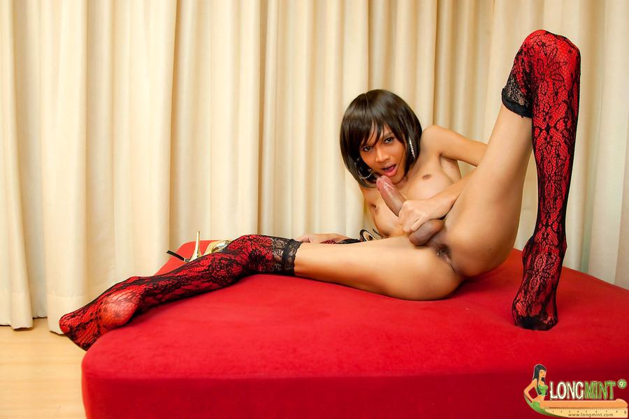 Freaky TGirl Jams Her Stiletto Heels Into Her Bum