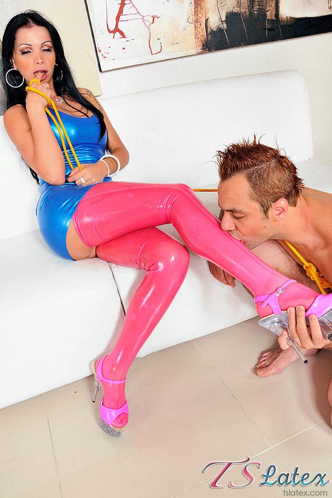 Latex Clad T-Girl Carla Novaes In Action