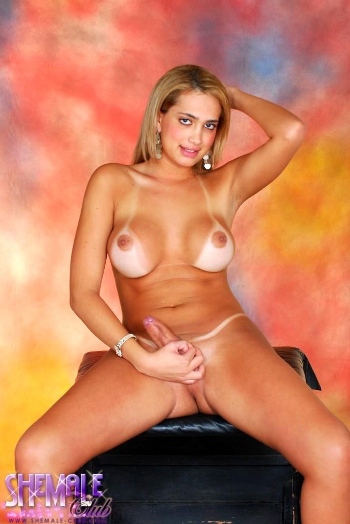 Pretty Transsexual Posing In Yummy Black Miniskirt