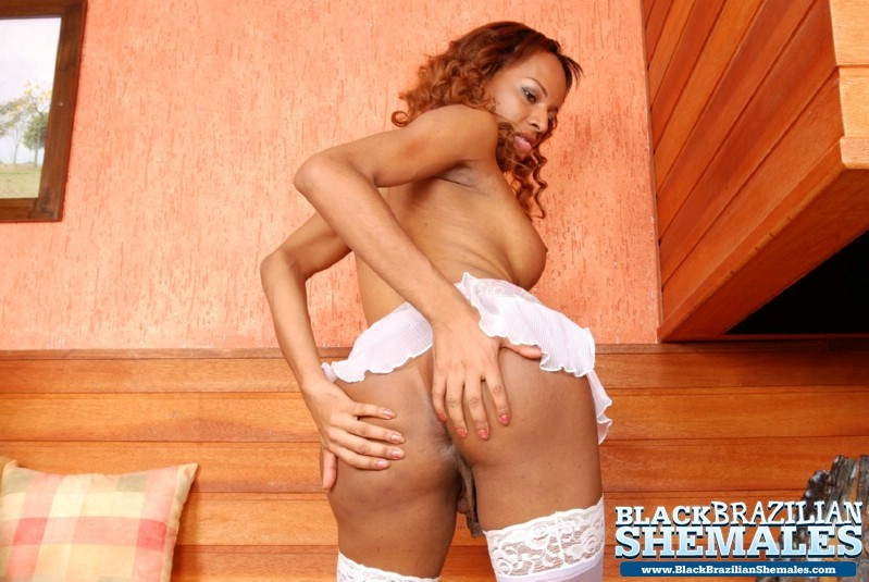Sweet T-Girl Spreads Her Nyloned Legs Wide