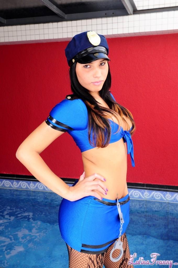 Voluptuous Brunette Transexual Dany Novaes Posing As A Cop